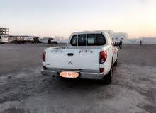 White Mitsubishi Pickup 2011 for sale