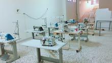 فني تركيب مشاغل خياطة وماكينات
