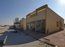 للبيع مبني تجاري في منطقه الزاهيه موقع ممتاز