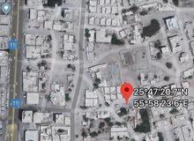 للبيع ارض سكني استثماري براس الخيمه منطقه العريبي