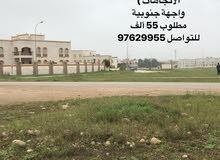 ارض للبيع بالسعادة الوسطى شمال جامعة ظفار سابقا على شارع رئيسي