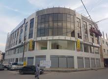 محلات ومكاتب للايجار بدون خلو في مجمع تجاري بناء جديد