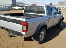 Silver Nissan Pickup 2000 for sale