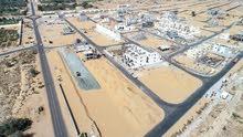 للبيع اراضى تجاريه بالزاهيه عجمان قريب الحليو وشارع الشيخ محمد بن زايد