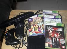 xbox 360 for sell with 4 games with controller + kinect sensor no damages
