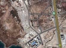 900م تجاري في البحر الميت في السويمة قريبة من الهولدي ان السعر 180000