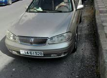 Nissan Sunny car is available for a Day rent