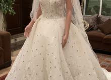 فستان ابيض مع الطرحه انيق للعرائس بإطلاله جميله ومميزه