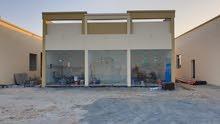 مبنى محلات تجارية للبيع فى الزاهية ع شارع 36 متر- موقع حيوي-تملك حر-كل الخدمات-عائد 10% ` QWR