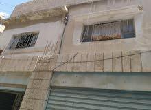 عمارة سكني تجاري للبيع الزرقاء