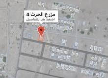 بركاء - مزرع الحرث سكنيه مخطط الارجان على شارع مرصوف وبقرب منازل قائمه .