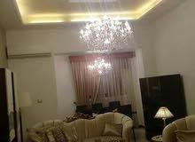 شقة ارضية في بن عاشور بها كراج كاملة الأثاث للبيع