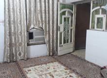 بيت نص قطعة في مدينه الصدر قرب سوك الوحيلات