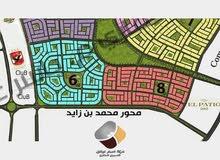 ارض 648 متر للبيع بالحي الثامن مشروع بيت الوطن بالتجمع الخامس علي حديقه رئيسيه