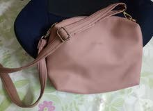 Secosana Sling bag.Whats app 0555610989