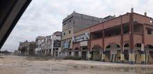 مبنى تجاري على شارعين وميدان في الصابري مقابل نادي التحدي