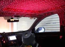 اضاءة لاسقف السيارة واوض النوم لون احمر على شكل نجوم