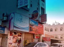 For rent a new commercial building in Umm Al-Hassam