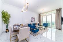 شقة غرفتين وصالة بدفعة أولى 20 ألف درهم فقط وإطلالة مائية رائعة  أقساط ميسرة ل 7 سنوات