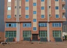 بناية سكني تجاري في عوقد الشمالية
