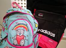 a kids school bags from Adidas and momento in a very good situation