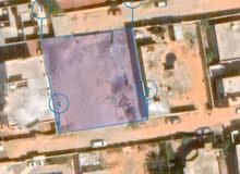 قطعة أرض سكنية للبيع عين زارة طريق زويته الحمودات قرب صيدليةالفردوس المركزية.