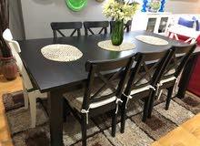 طاولة سفرة من ايكيا قابلة للفرد اسود اللون مع 8 كراسي بغطاء من ايكيا موديل مميز