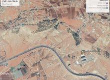 أرض للبيع دونم فوق شارع الأردن على تلة خلف جامعة عمان العربية اطلالة بانوراما ..