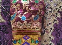 خياطة زي عماني تقاليدي