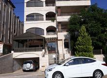 شقة طابقية فاخرة في حنوطيا (ضاحية الامير راشد)  وبسعر لقطه للبيع