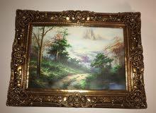 لوحة فنية للطبيعة مع برواز ذهبي