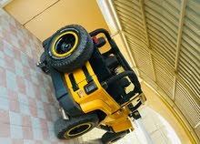 جيب رانجلر سبورت 2015 اللون اصفر