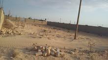 قطع ارض في اجدابياا علي طريق طبرق