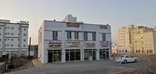بنايه تجاريه مؤجره للبيع في المعبيله بعد جامع تيمور