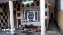 بيت مساحة 105  واجهة 5.5   بغداد الاعظمية خلف جامع العساف