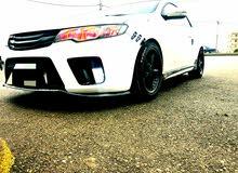 Automatic White Kia 2013 for rent