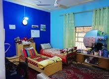 دار للبيع في العامريه محلة638 المساحة 340م