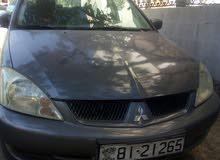 سياره ميتسوبيشي إعفاء موديل 2011