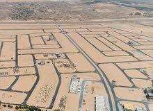 للبيع ارض سكنية  منطقة الزاهية - متكاملة الخدمات - على ش الشيخ محمد بن زايد - عجمان  RT