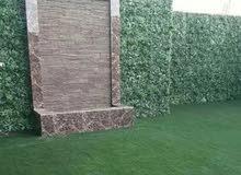 مصمم شلالات وتنسيق الحدائق