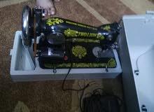 مكينة خياطه تعمل على الكهرباء