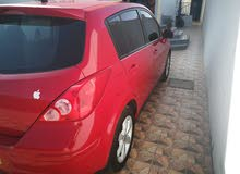 Red Nissan Versa 2011 for sale