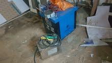 مكينة لحام حديد مع عدة حداد