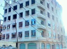 عماره سته دور وبدروم حجر 16 شقه و9 دكاكين شارعين زفلت