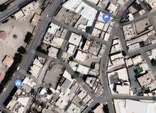 لدي ارض مبني عليها سكن للعمال في حي بريمان