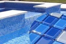 بلاط حمام السباحه الموزايك العادى ب 165 جنيه والزجاج 285 جنيه للمتر المربع