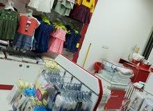 محل ملابس أطفال للبيع