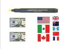 قلم لكشف العملة