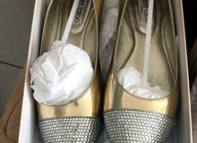 Tory Burch size 37 used only once Jimmy Choo size 37 used once