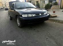Best rental price for Kia Sephia 1995